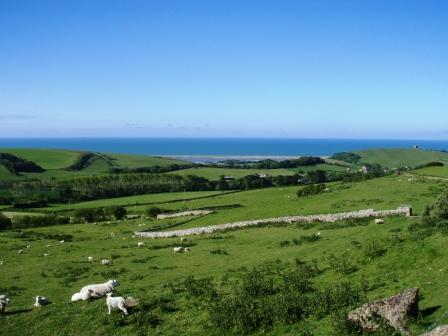 A long view of Abbotsbury and the coast area from the base of the downs