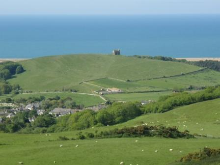 From the high ground, the village of Abbotsbury and Dorset's World Heritage Coast